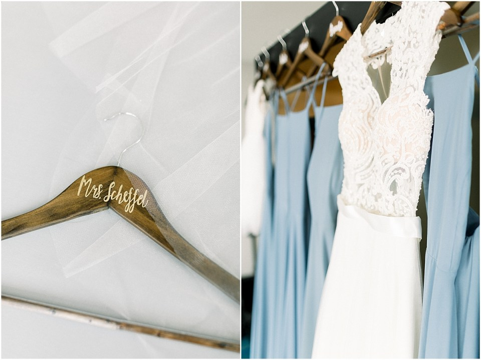 Arielle Peters Photography | Wedding gown hanging next to the bridesmaids dresses at The Blue Heron at Blackthorn in South Bend, Indiana on wedding day.