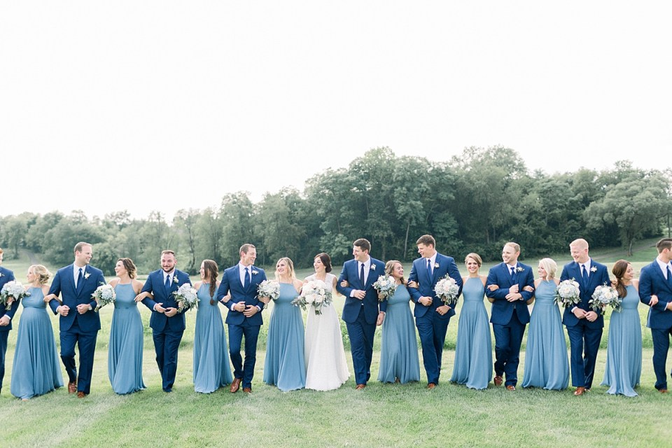 Arielle Peters Photography | Wedding party linking arms outside at The Blue Heron at Blackthorn in South Bend, Indiana on wedding day.