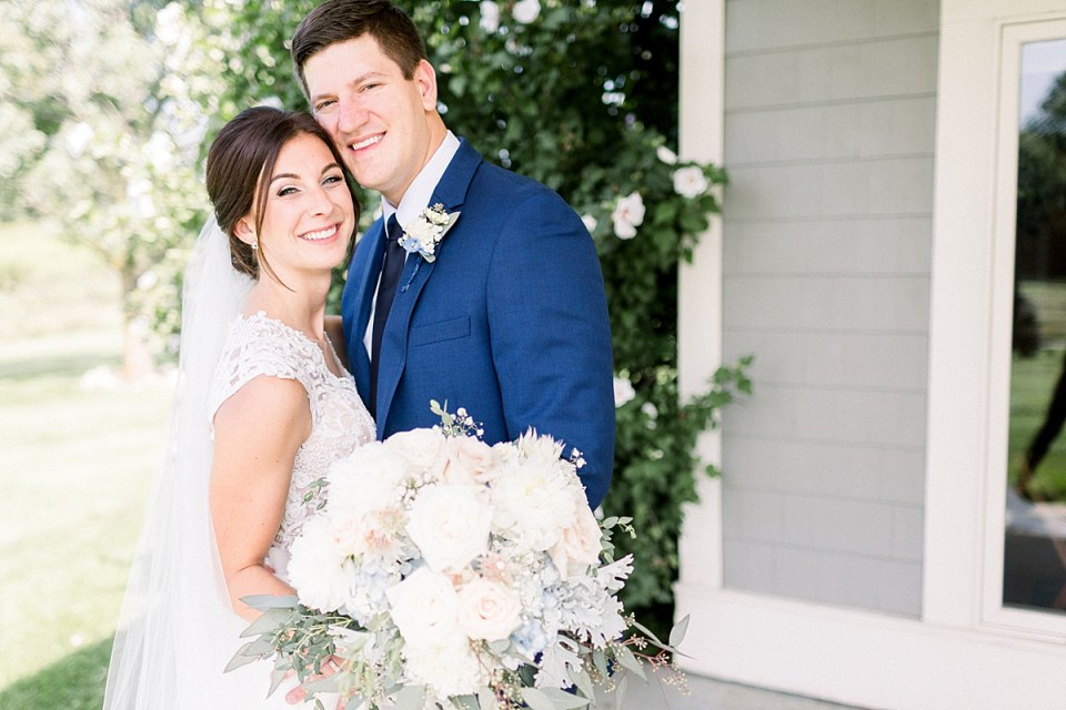 Arielle Peters Photography | Bride and groom smiling outside at The Blue Heron at Blackthorn in South Bend, Indiana on wedding day.