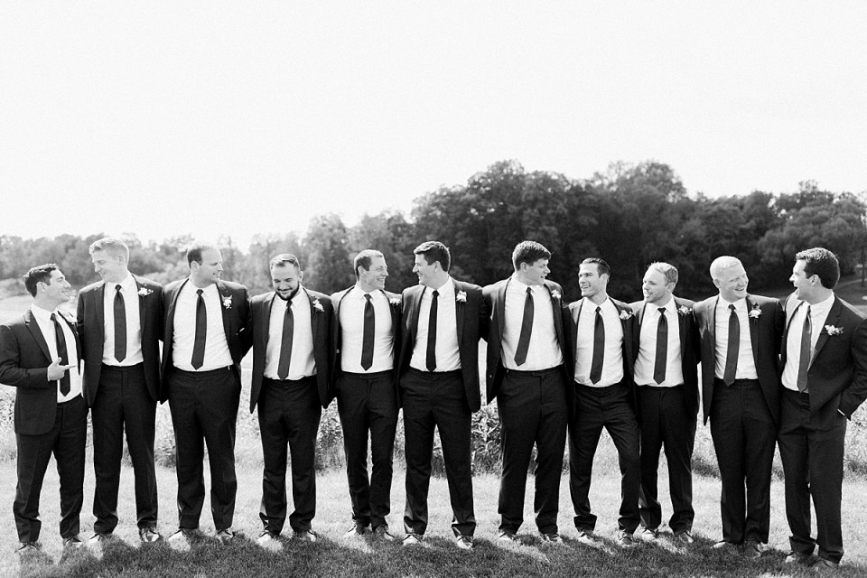 Arielle Peters Photography | Groom and groomsmen lined up outside at The Blue Heron at Blackthorn in South Bend, Indiana on wedding day.