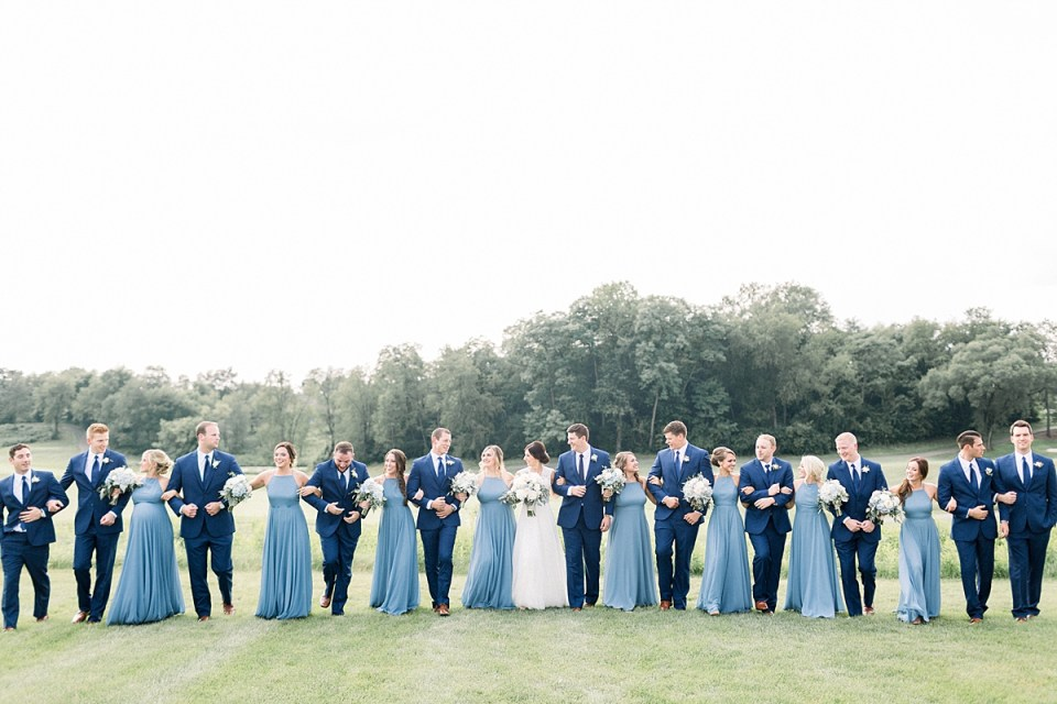 Arielle Peters Photography | Wedding party walking outside at The Blue Heron at Blackthorn in South Bend, Indiana on wedding day.