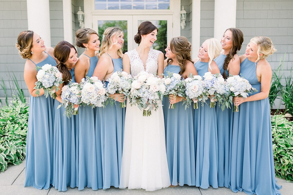 Arielle Peters Photography | Bride and bridesmaids laughing outside at The Blue Heron at Blackthorn in South Bend, Indiana on wedding day.