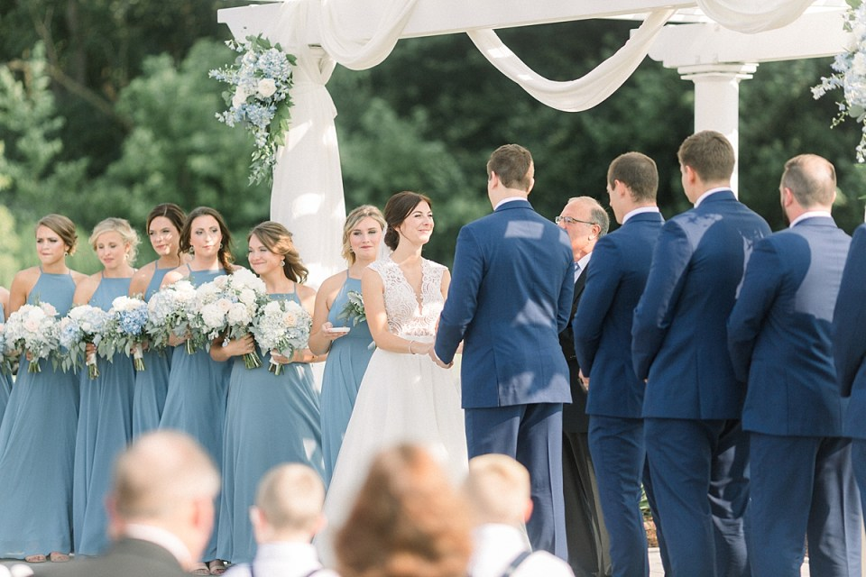 Arielle Peters Photography | Bride and groom holding hands at the alter at The Blue Heron at Blackthorn in South Bend, Indiana on wedding day.