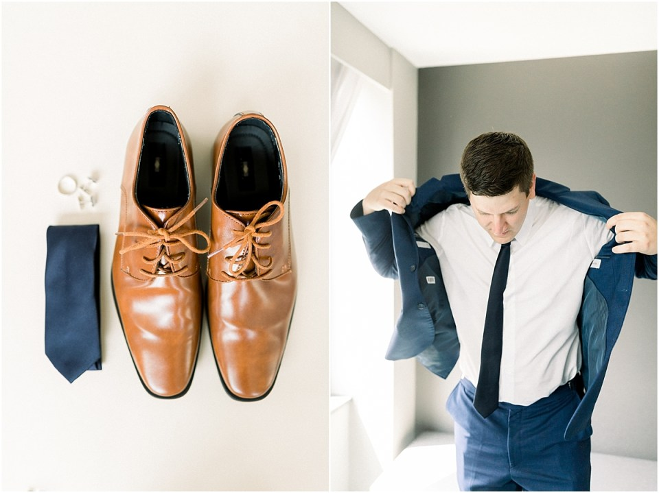 Arielle Peters Photography | Groom putting on suit jacket on wedding day at The Blue Heron at Blackthorn in South Bend, Indiana on wedding day.