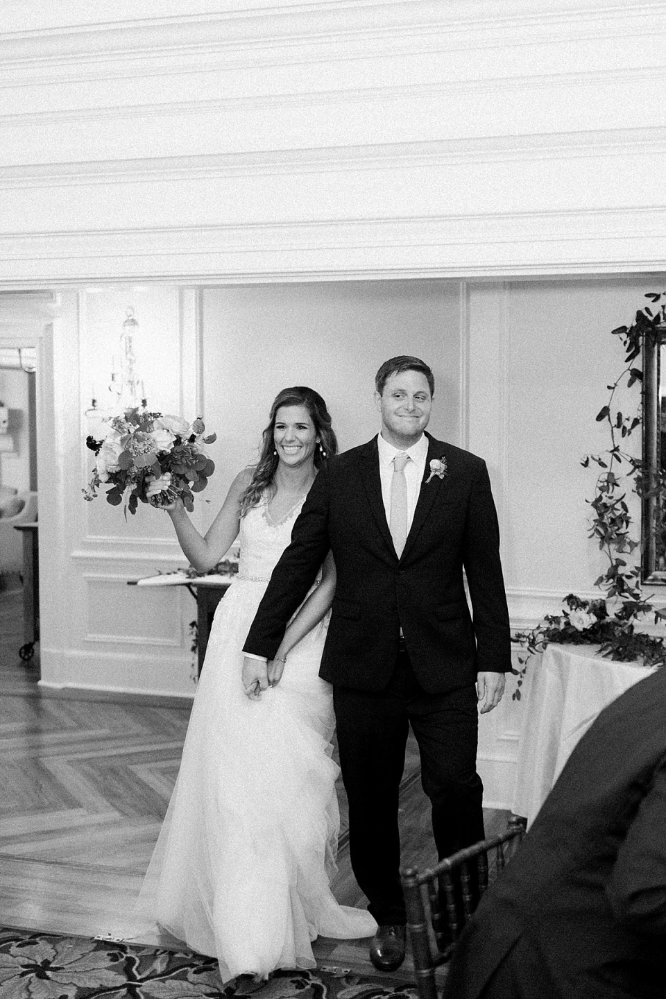 Arielle Peters Photography | Bride and groom entering wedding reception at Sycamore Hills Golf Club in Fort Wayne, Indiana on wedding day.