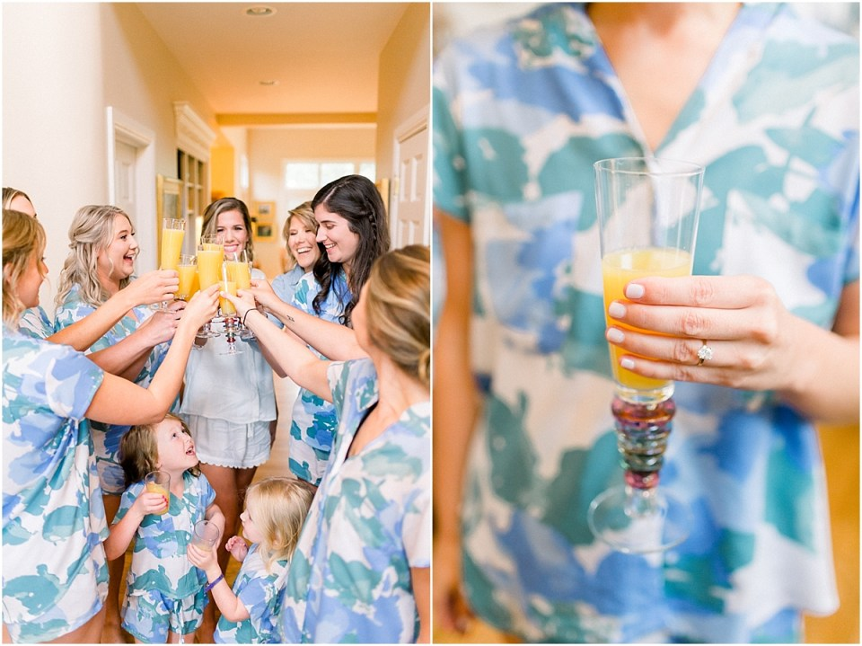 Arielle Peters Photography | Bride and bridesmaids drinking mimosas while getting ready for wedding at Sycamore Hills Golf Club in Fort Wayne, Indiana on wedding day.