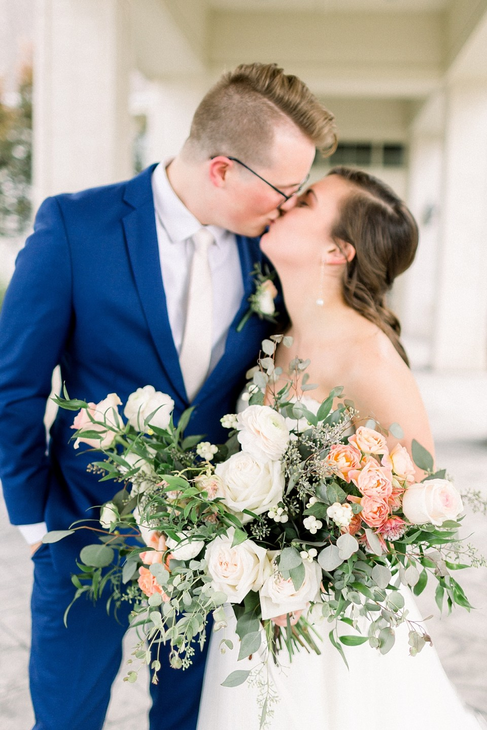 Arielle Peters Photography | Bride and groom kissing outside at The Bridgewater Club in Carmel, Indiana on wedding day.