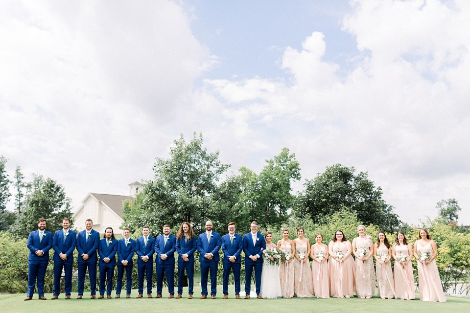 Arielle Peters Photography | Bride and groom and wedding party lined up outside at The Bridgewater Club in Carmel, Indiana on wedding day.