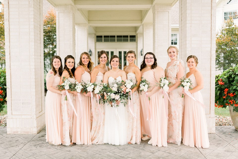 Arielle Peters Photography | Bride and bridesmaids smiling outside at The Bridgewater Club in Carmel, Indiana on wedding day.