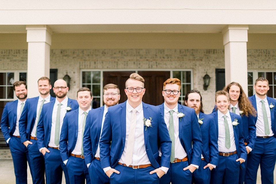 Arielle Peters Photography | Groom and groomsmen smiling with their hands in their pockets outside at The Bridgewater Club in Carmel, Indiana on wedding day.