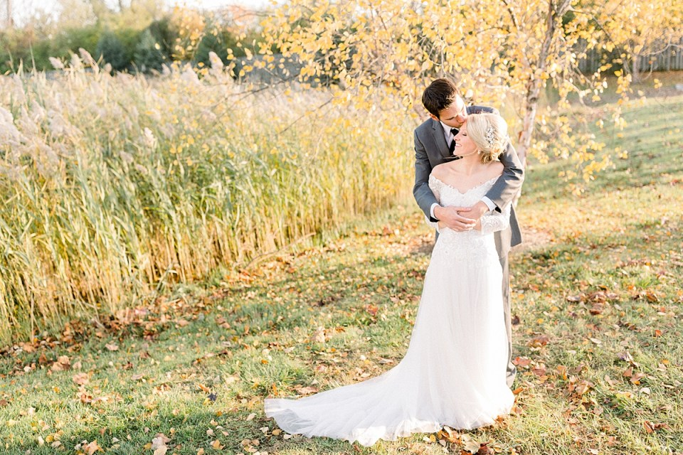 Arielle Peters Photography taking a couple's fall wedding day photos at Bethany Baptist Church in Troy, Michigan.