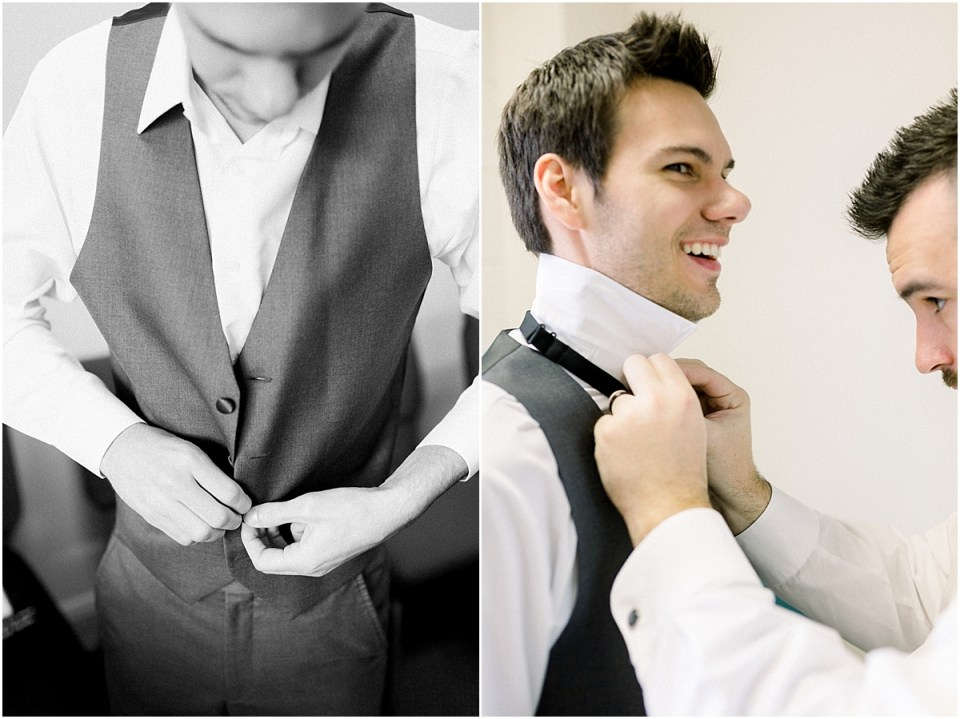Arielle Peters Photography | Groomsman helping tie the groom's tie on his wedding day.
