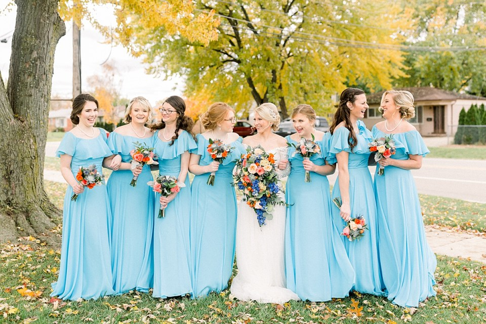 Arielle Peters Photography | Bride and bridesmaids smiling outside on fall wedding day.