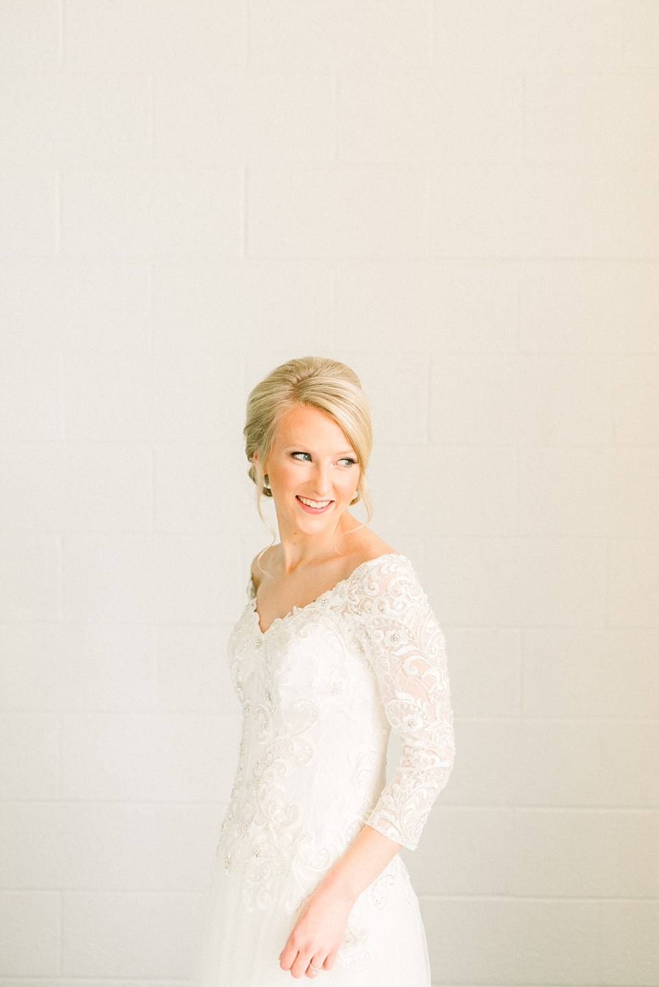 Arielle Peters Photography | Bride smiling in her dress on her fall wedding day.