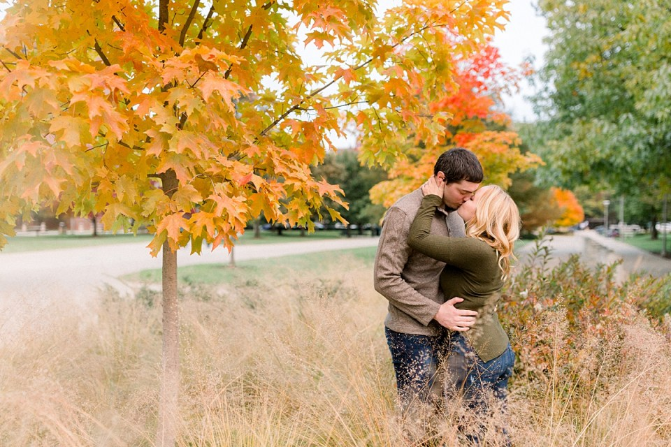 Arielle Peters Photography | Couple kissing and taking fall engagement photos in a field at Purdue University.