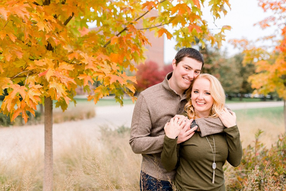 Arielle Peters Photography | Couple smiling and taking fall engagement photos at Purdue University.