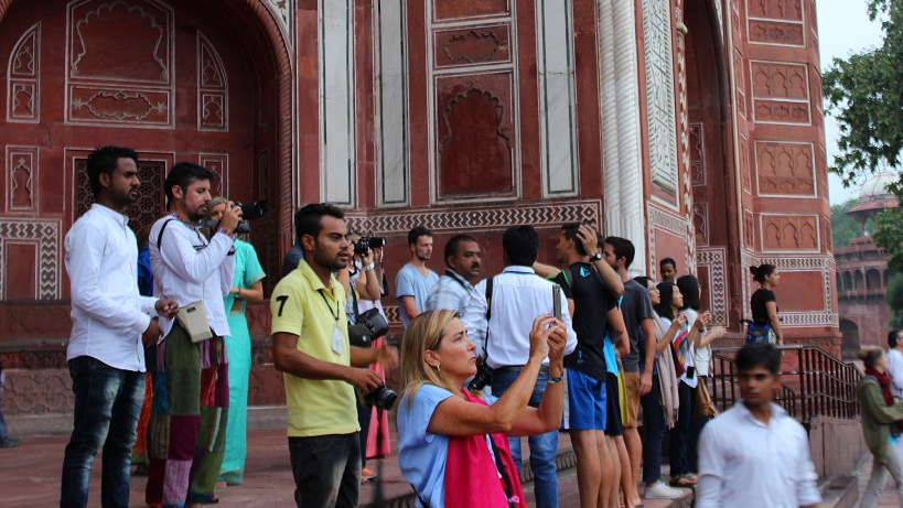 Taj Mahal Photography tips? Tourists taking pictures of Taj Mahal early in the morning.