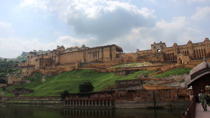 Amer or Amber Fort near Jaipur on a hilltop with a body of water in front.