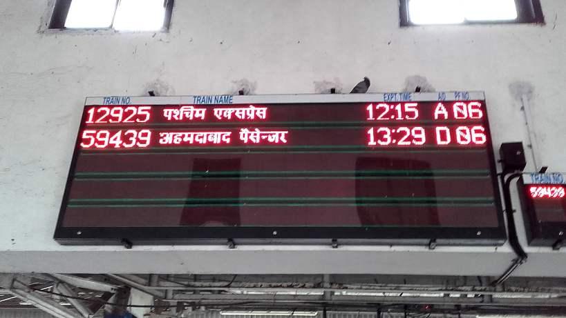 Train timetable with writing in Hindi in Mumbai.