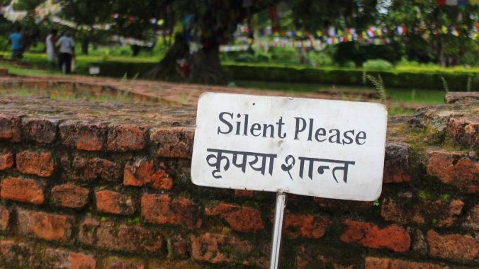 """A sign near the birthplace of Buddha saying """"Silence Please""""."""
