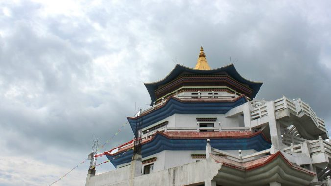 The white and blue tower of a monastery in Lumbini.