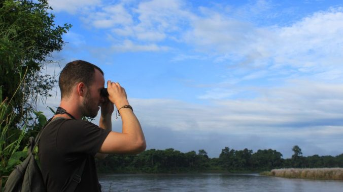 French backpacker Baptiste spotting rhinos.