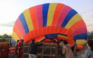 Inflating hot air balloon in the airport of Vang Vieng, Laos.