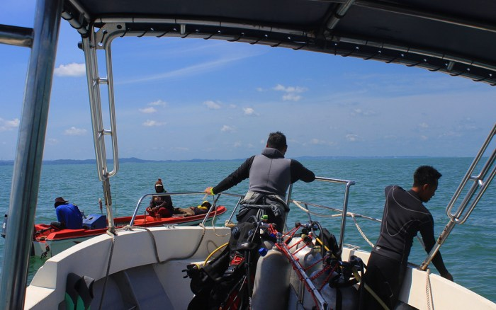 Scuba diving in Brunei Darussalam. Taking a boat to the diving sites.