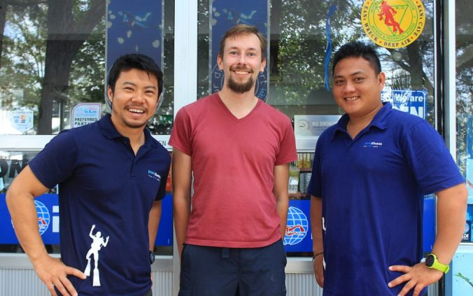 Arimo Koo with workers of Poni Divers diving school in Brunei.