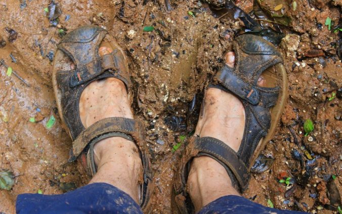 Sandals on wet mud in Tonga.