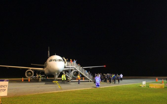 A flight boarding in Nuku'alofa airport, Tonga. Best travel tips for long-term travel.