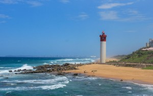 Umhlanga Rocks lighthouse with downtown Durban in the background.