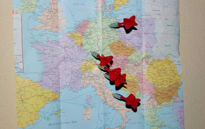 Throwing darts on the map of Europe to choose InterRail destinations.
