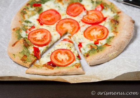 Pesto Pizza with roasted red pepper, tomato and roasted corn