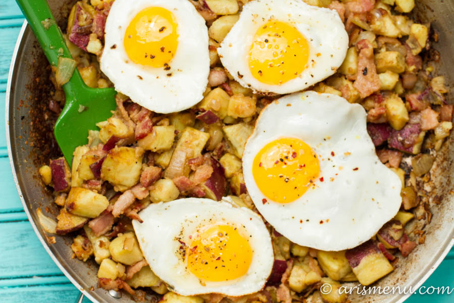 Paleo Sweet Potato Breakfast Hash: Warm, hearty and comforting breakfast hash with sweet potato, onions, center cut bacon and fried eggs. So easy and crave-able!
