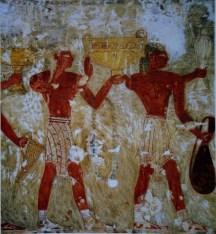 Άνδρες με χαρακτηριστικά Μινωικά περιζώματα προσφέρουν κρητικά μεταλλικά αγγεία στην Αιγυπτιακή αυλή.