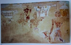 Άνδρες με χαρακτηριστικά Μινωικά περιζώματα προσφέρουν κρητικά αγγεία (προσέξτε τις κεφαλές ταύρου) στην Αιγυπτιακή αυλή.