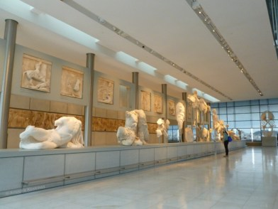 New Acropolis Museum: the Western Pediment of the Parthenon, showing the contest between Athena and Poseidon. Behind the pediments badly damaged statues, the temple's metopes and frieze are also exhibited.
