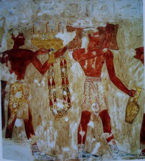 Men in Minoan-style loincloths bringing valuable items to the Egyptian court.
