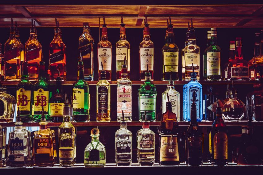 A wall of alcoholic spirits in a possibly haunted pub