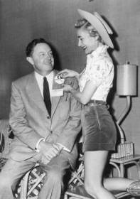 """Connie Cook aka Lil' Dudette is pictured pinning the """"Phoenix in '57"""" button on then American National Cattlemen's President Jay Taylor."""