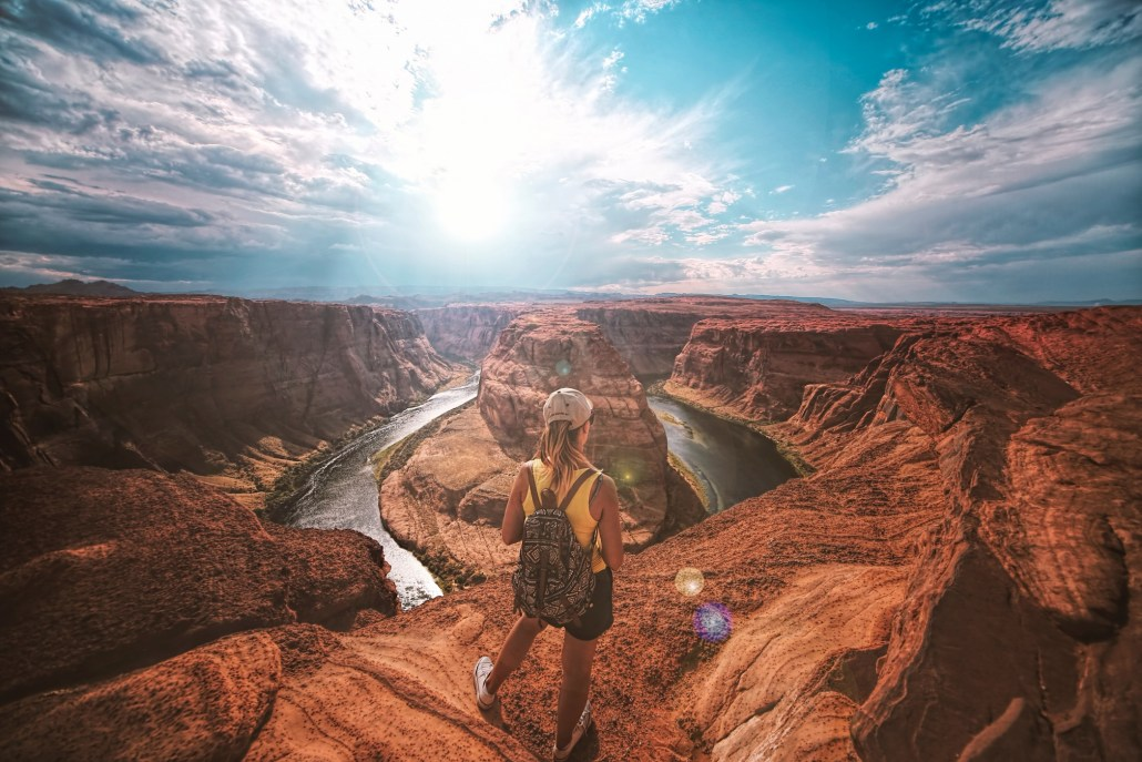Visitor looking out over Horseshoe bend in Arizona