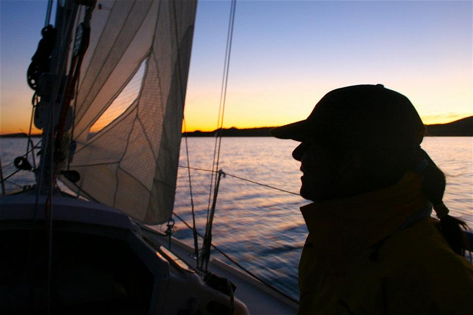 Sheila Reed silhouetted at sunset during the Governor's Cup. Photo: Chris Smith