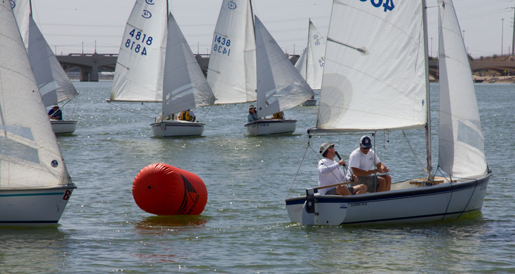 Trey and Mike Hester trim in for the upwind finish only to find they can't hold port tack close-hauled.