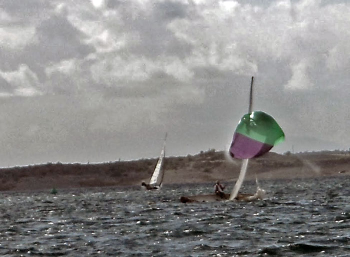 Blustery winds toss one of the Thistle fleet around. And over. Photo: Kyle Clark