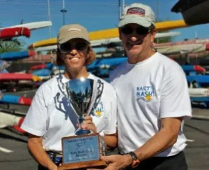 Maryellen Ferring with crew Mike Ferring holding the trophy for winning the 2014 Ruth Beals Regatta. Photo: Victor Felice