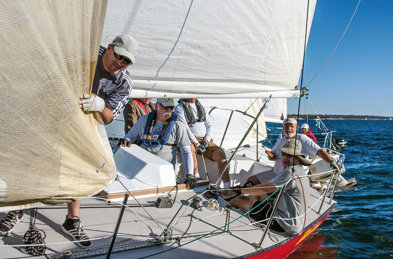 The crew of Bitchen' crosses the finish. Photo: Charles Landis