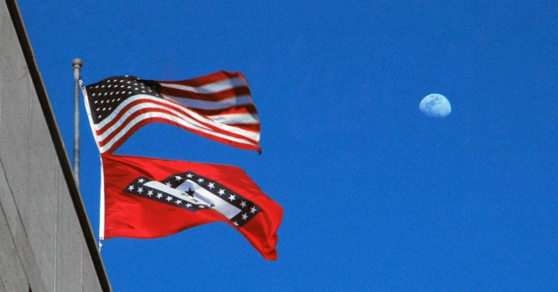 American Flag and Arkansas Flag with moon in background