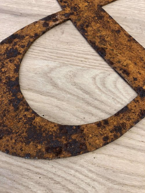 Metal Rusty & we love them like this for outdoors or in side! These are lazer cut from steel. You could rub them back with sand paper if you would prefer? See pictures for more detail, degree of rust and exact colour may vary. Size: 35cm x 33cm x 2mm thick. £11  (3.95 P&P)
