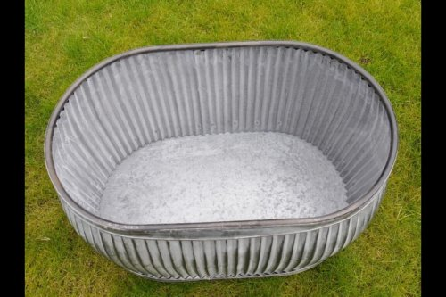 Galvanised Metal Planter Tubs Oval from arkvintage. Classic ribbed planters in galvanised metal. Fabulous vintage look for your garden trees, plants or herbs etc. Available online now in 3 sizes.